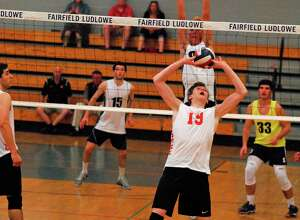 Ridgefield's Nick Laudati sets the ball during FCIAC semifinal action against Staples on Wednesday. Laudati had 20 kills and 10 blocks as the Tigers won 3-1.