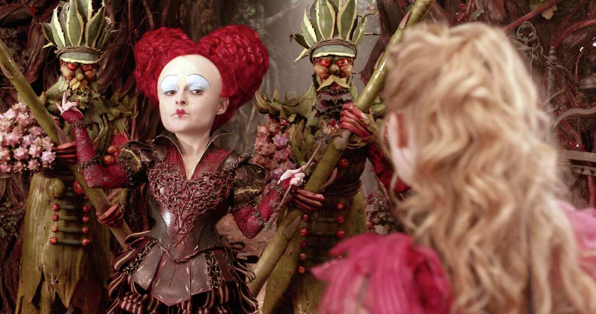 """In this image released by Disney, Helena Bonham Carter, left, and Mia Wasikowska appear in a scene from """"Alice Through The Looking Glass."""" (Disney via AP)"""