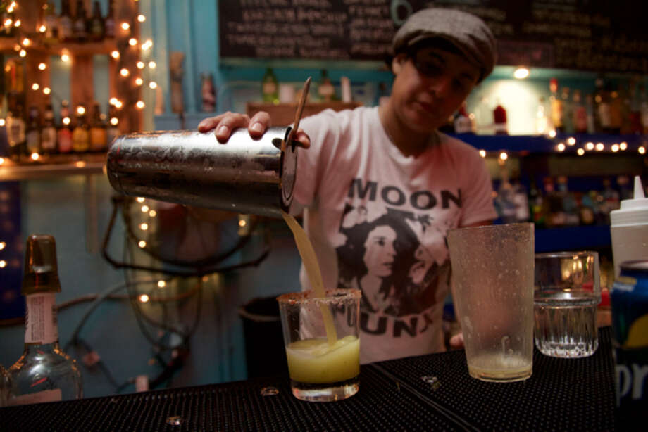 Monica Moreno is making a drink at La Botanica.