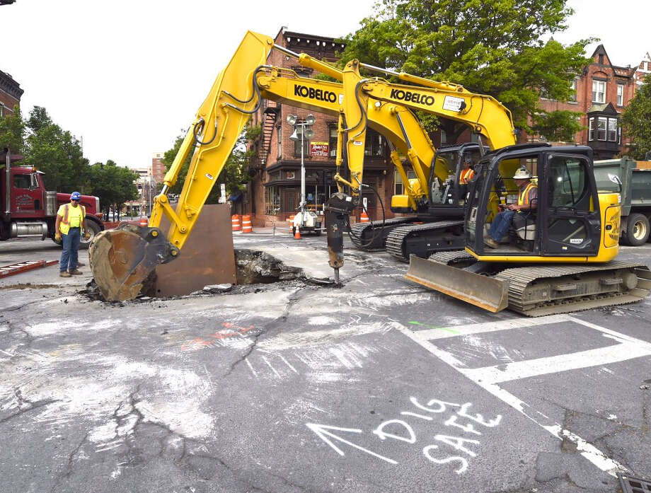 Work continues on a sinkhole at the intersection of Madison and New Scotland Avenues in Albany, N.Y. on Thursday, May 26, 2016 (Skip Dickstein / Times Union)