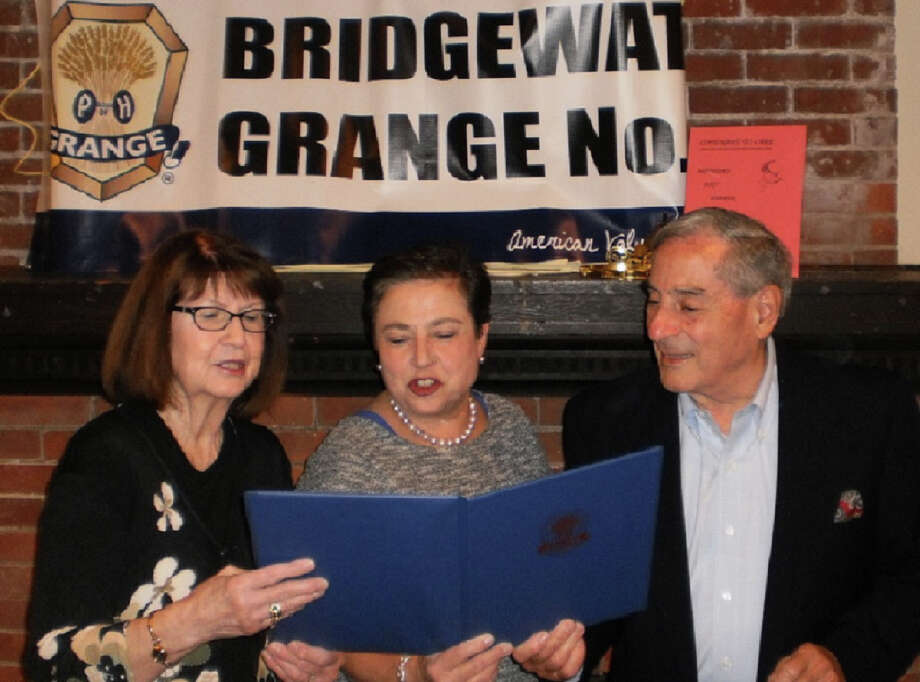 The Bridgewater Grange recently presented its annual Bridgewater Grange Community Service Award to Joe and Adrian Caruso of Bridgewater, shown above being congratulated by Grange Master Nancy Mascio, left. Photo: Courtesy Of Bridgewater Grange / The News-Times Contributed