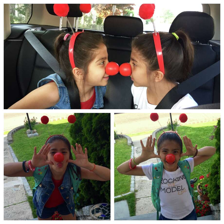Toquam Magnet School (Stamford) students supporting the cause on the way to school. Photo: Denise Campos