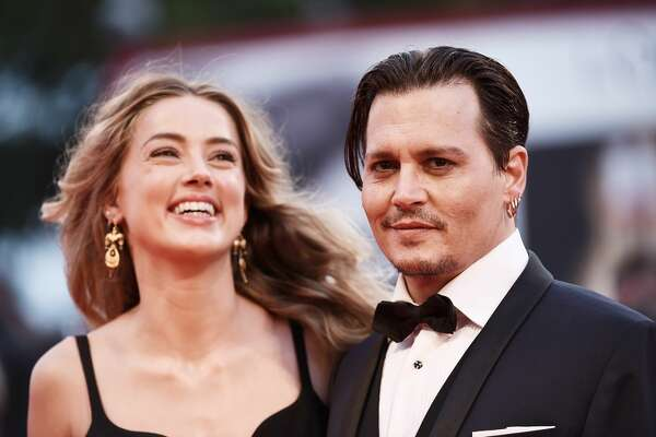 VENICE, ITALY - SEPTEMBER 04:  Johnny Depp and Amber Heard attend a premiere for 'Black Mass' during the 72nd Venice Film Festival at  on September 4, 2015 in Venice, Italy.  (Photo by Ian Gavan/Getty Images)