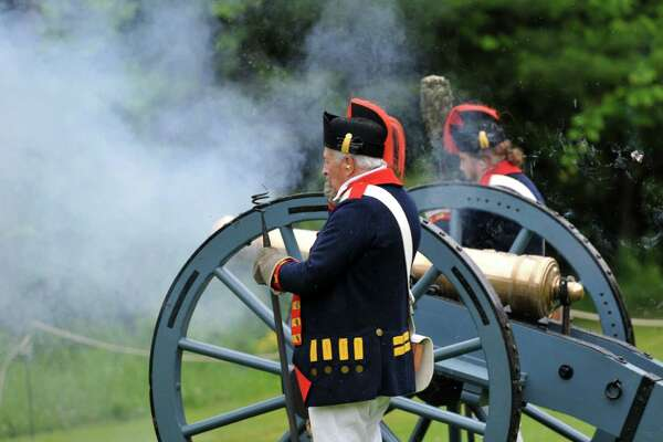 The cannon goes off for the Cannon Salute during the 12th Annual Citizenship Ceremony Saturday, July 4, 2015, at Saratoga National Historical Park in Stillwater, N.Y. (Phoebe Sheehan/Special to The Times Union)
