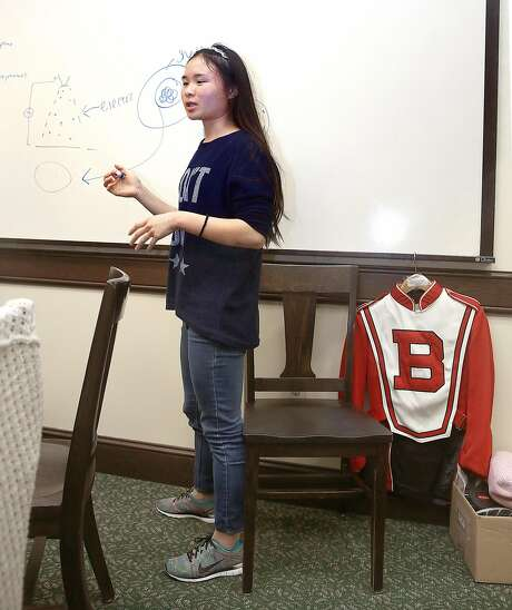Burlingame High student Vivian Yuen, 15, one of the students in charge of the vaccine portion of the program, speaks at a meeting of the group. She's also a member of the school band. Photo: Liz Hafalia, The Chronicle