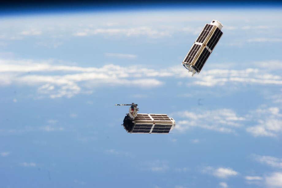 Modular CubeSats deployed from the International Space Station. Photo: NASA