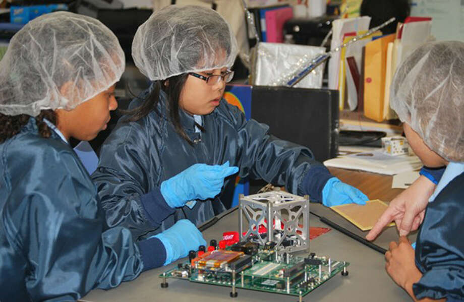 Pre-K through 8th grade students at St. Thomas More Cathedral School in Arlington, Virginia designed, built and tested a CubeSat that was deployed in space. Photo: NASA, **