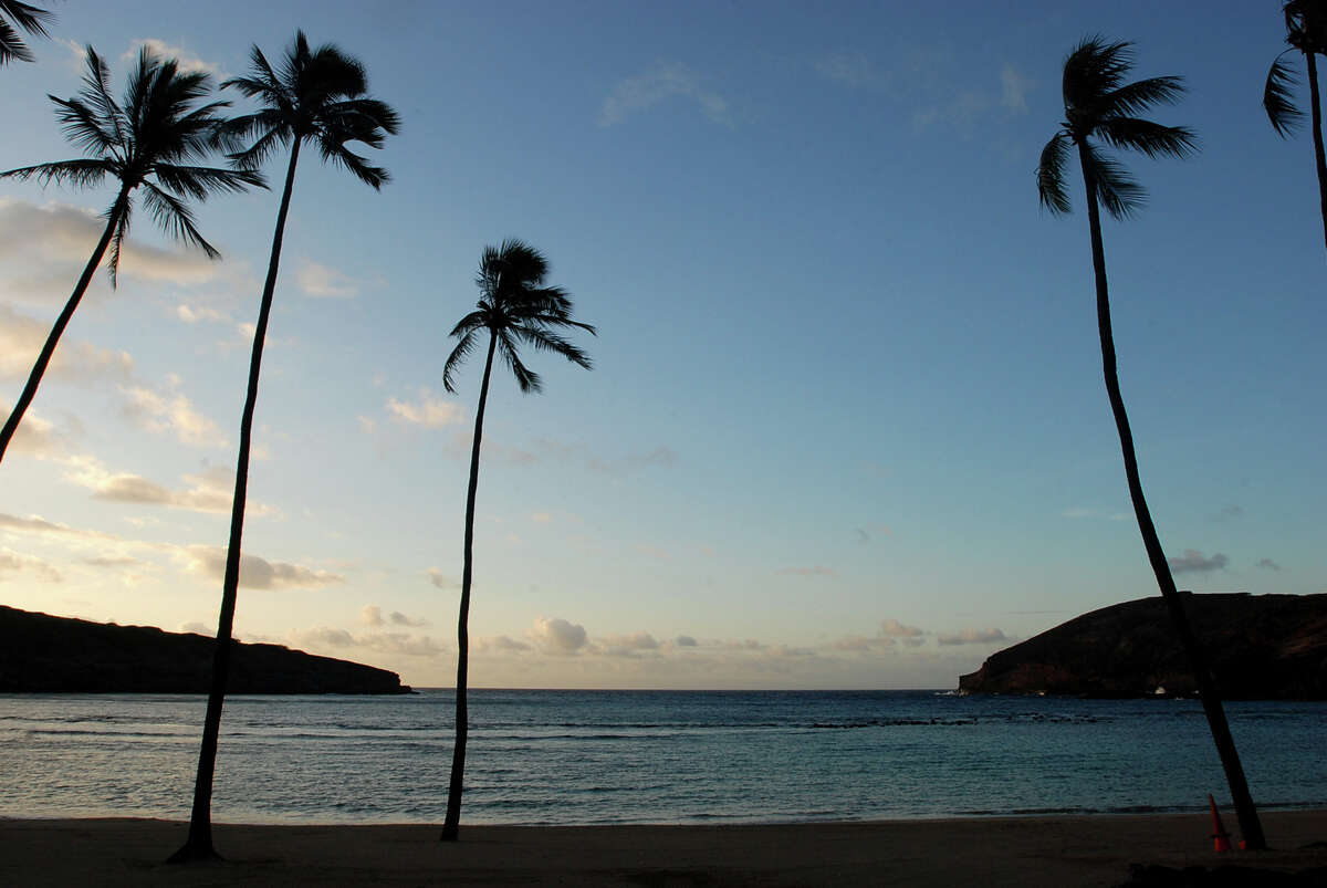 Oahu's Hanauma Bay, Honolulu: In this May 11, 2016 photo, the sun rises over Oahu's Hanauma Bay near Honolulu. Hanauma Bay is No. 1 on the list of best beaches for the summer of 2016 compiled by Stephen Leatherman, also known as Dr. Beach, a professor at Florida International University.