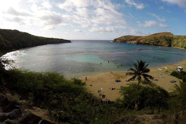 In this May 11, 2016 photo, people swim in Oahu's Hanauma Bay near Honolulu. Hanauma Bay is No. 1 on the list of best beaches for the summer of 2016 compiled by Stephen Leatherman, also known as Dr. Beach, a professor at Florida International University.