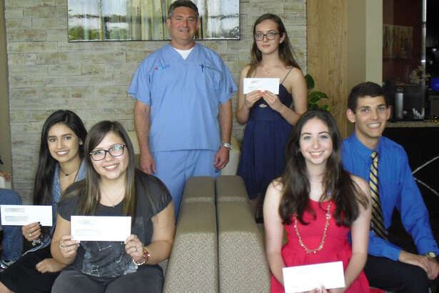ER Katy Medical recently provided scholarships to Katy-area students for the third consecutive year. From left, back row, are: Ethan Brown, ER Katy medical director, and first-place scholarship winner Angelika Kurpan; front row: Second-place winners Madison Zapata and Alyssa Ontiveros and  third-place winners Carly Luczak and David Roy.