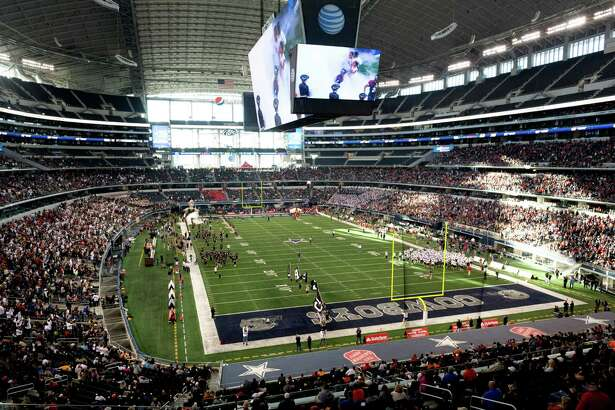 Pearland players take the field to face Allen in the Class 5A Division I state football championship game at AT&T Stadium on Dec. 21, 2013, in Arlington.