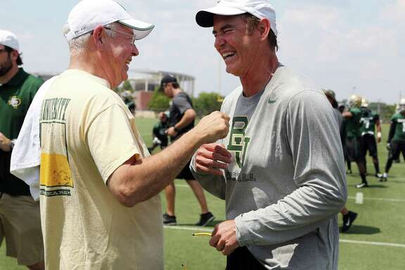 """FILE - In this Aug. 5, 2014, file photo,Baylor University President Ken Starr, left, jokes with head football coach Art Briles, right, on the first day of NCAA college football practice in Waco, Texas. Baylor University's board of regents says it will fire Briles and re-assign Starr in response to questions about its handling of sexual assault complaints against players.  The university said in a statement Thursday, May 26, 2016, that it had suspended Briles """"with intent to terminate.""""  Starr will leave the position of president on May 31, but the school says he will serve as chancellor. (Rod Aydelotte/Waco Tribune-Herald via AP, File) MANDATORY CREDIT"""