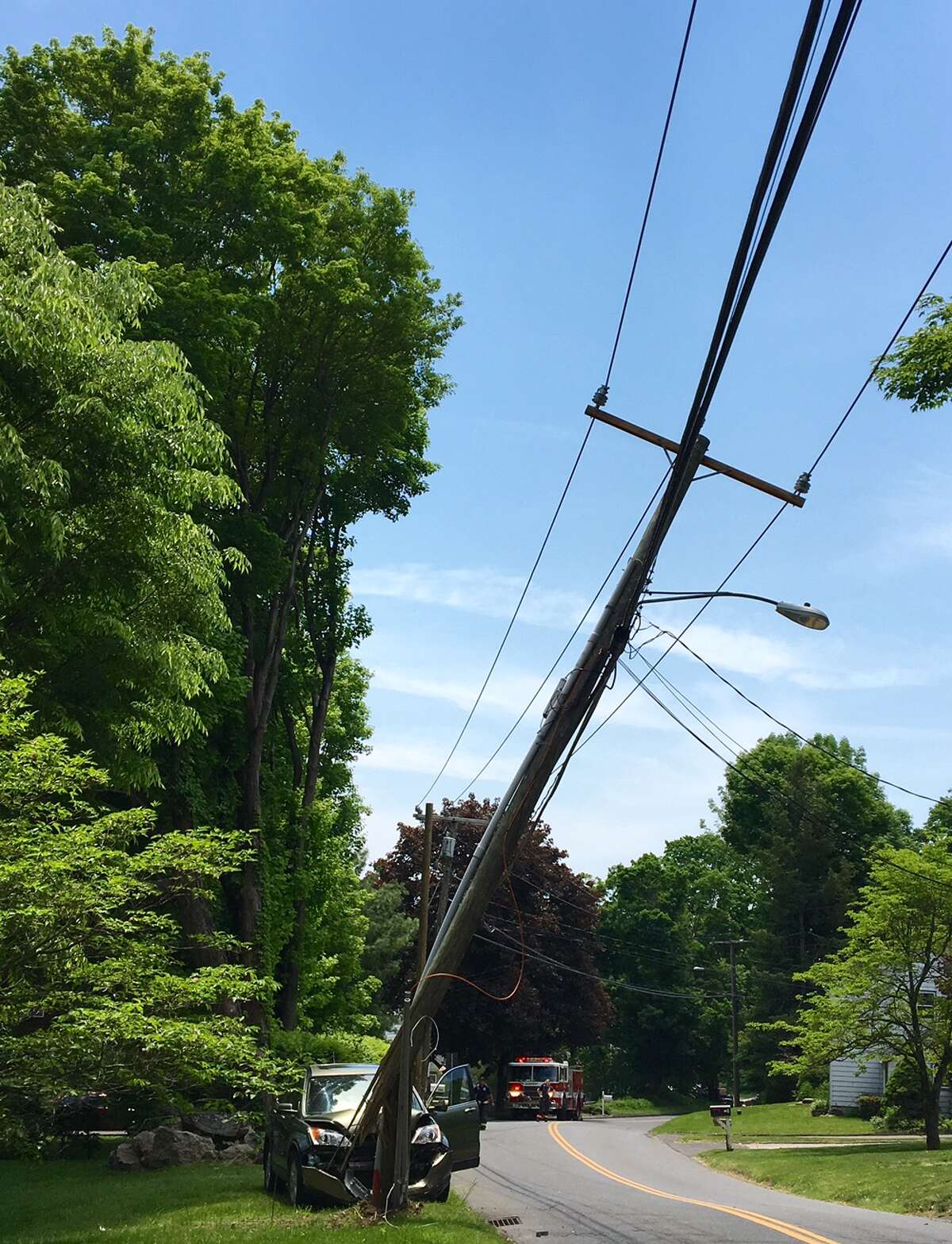 A crash snapped pole on Great Plain Road in Danbury on Wednesday, May 25, 2016.