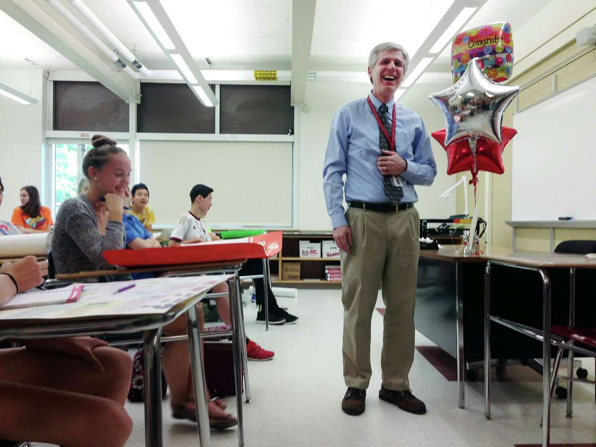 Niskayuna High School English teacher James Edgar is surprised in his classroom by administrators and members of the Niskayuna Community Foundation on Thursday, May 26, 2016, in Niskayuna, N.Y. Edgar was one of the recipients of the foundation's Murray Award for Excellence in Education. (Paul Buckowski / Times Union)