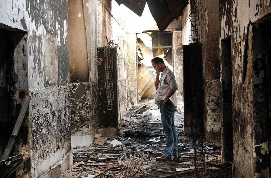 A hospital employee of Doctors Without Borders examines the damage after a 2015 U.S. air strike in Kunduz, Afghanistan. Photo: Najim Rahim, Associated Press