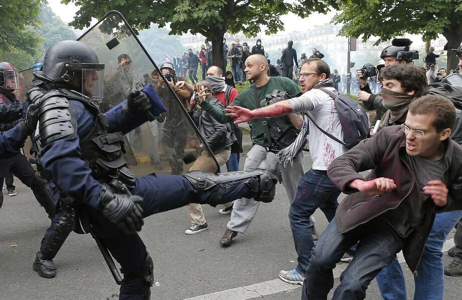 Riot police officers clash with protestors during a demonstration in Paris. Photo: Francois Mori, Associated Press