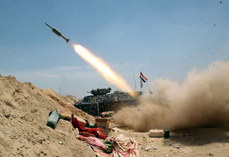 Iraqi government forces fire a rocket near al-Sejar village, north-east of Fallujah, as they take part in a major assault to retake the city from the Islamic State. Photo: AHMAD AL-RUBAYE, AFP/Getty Images
