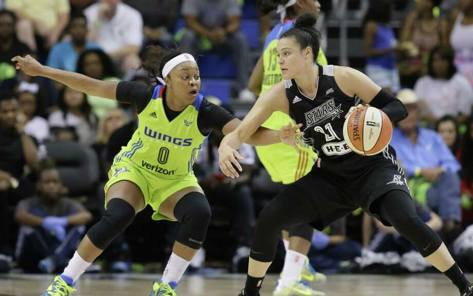 San Antonio Stars guard Kayla McBride drives against the Dallas Wings in a recent WNBA game. With all the media attention on the Spurs, a reader says, teams like the Stars get short shrift. Photo: LM Otero /Associated Press / AP