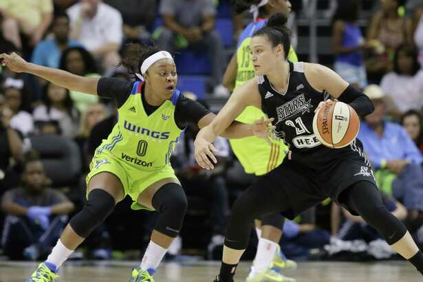 San Antonio Stars guard Kayla McBride drives against the Dallas Wings in a recent WNBA game. With all the media attention on the Spurs, a reader says, teams like the Stars get short shrift.