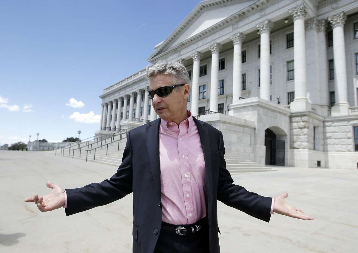 Tormer New Mexico Gov. Gary Johnson leaves the Utah State Capitol after meeting with with legislators in Salt Lake City.
