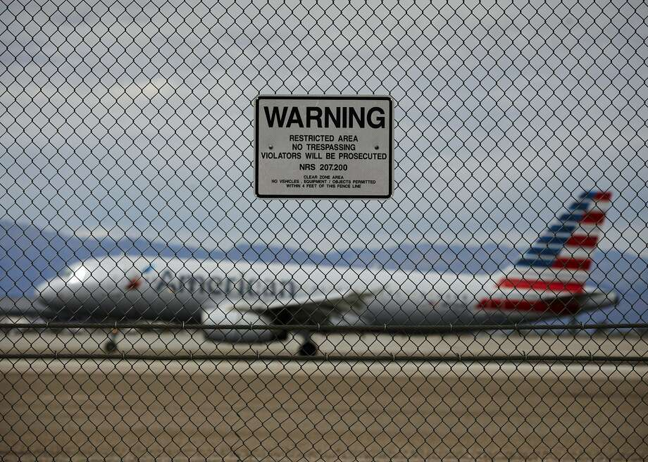 A sign warns against trespassing at McCarran International Airport in Las Vegas. An Associated Press investigation has documented breaches at many of the busiest U.S. airports. Photo: John Locher, Associated Press
