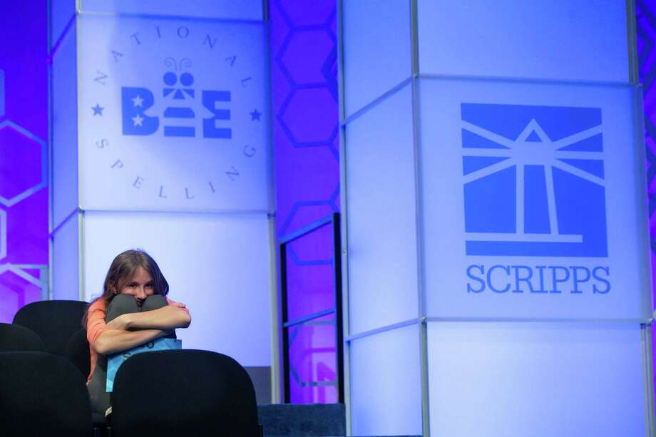 Sylvie Lamontagne, 13, from Lakewood, Colo., waits for her turn to spell during the final round of the Scripps National Spelling Bee in National Harbor, Md., Thursday, May 26, 2016. Photo: Cliff Owen, AP / (C)Cliff Owen