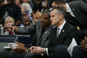 Oklahoma City Thunder assistant coach Maurice Cheeks, back, confers with Oklahoma City Thunder head coach Billy Donovan in the first half of an NBA basketball game Tuesday, April 5, 2016, in Denver. (AP Photo/David Zalubowski)