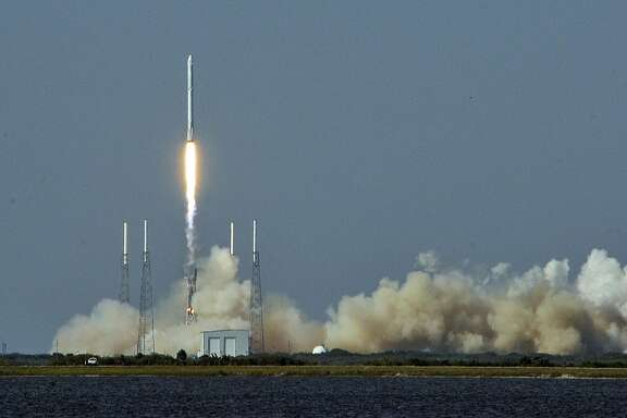 Space X's Falcon 9 rocket lifts off with an unmanned Dragon cargo craft from the launch platform in Cape Canaveral, Florida on April 8, 2016.   After four failed bids SpaceX finally stuck the landing, powering the first stage of its Falcon 9 rocket onto an ocean platform where it touched down upright after launching cargo to space. / AFP PHOTO / BRUCE WEAVERBRUCE WEAVER/AFP/Getty Images