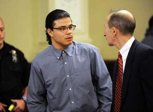 """Gabriel """"Gabe"""" Vega talks to his defense attorney Frederick Rench during closings statements in his trial for killing his former girlfriend Vanessa Milligan on Thursday, May 26, 2016 in Troy, N.Y. (Lori Van Buren / Times Union)"""