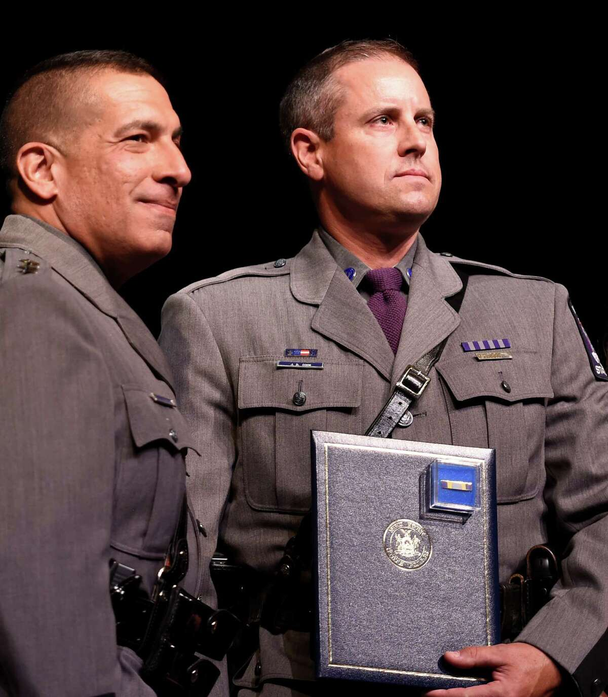 Superintendent Joseph D'Amico, left presents a commendation to Technical Sergeant Jay D. Cook for his capture of convict David Sweat who broke out of Dannemora Prison during the Superintendents Commendation Awards ceremony held this year at The University at Albany Thursday morning May 26, 2016, in Albany, N.Y. (Skip Dickstein/Times Union)