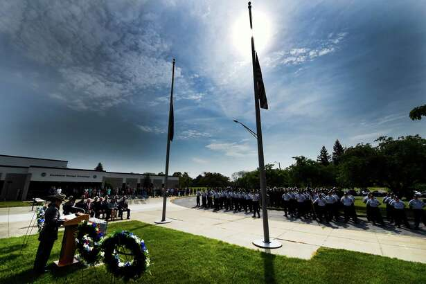Flags are at half staff at the Memorial Ceremony at the State Police Academy Thursday morning May 26, 2016, in Albany, N.Y.  (Skip Dickstein/Times Union)