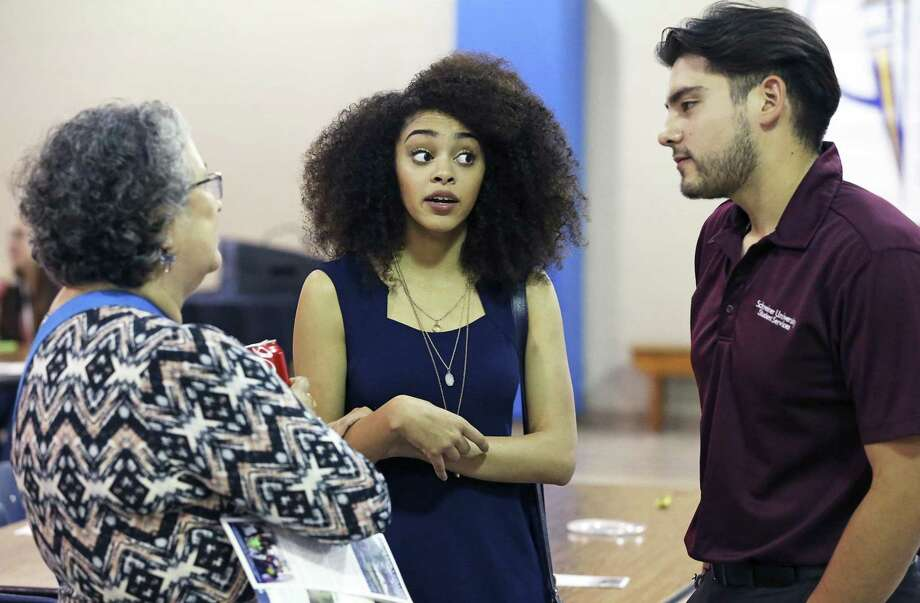 Savanna Villanueva revisits Travis Early College High School in 2016, where she had graduated at age 15, and talks with Nellie Gomez Shannon (a school supporter) and classmate Andrew Arnold. The Greehey Foundation has committed $1.5 million to help the San Antonio Independent School District teach dual credit students for the next three years. Photo: TOM REEL /SAN ANTONIO EXPRESS-NEWS / 2016 SAN ANTONIO EXPRESS-NEWS