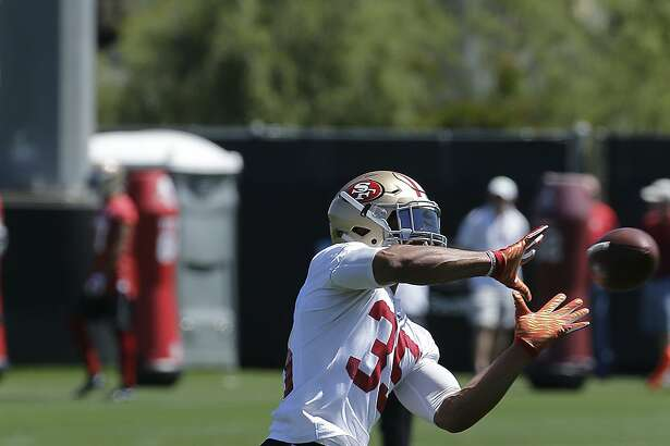 San Francisco 49ers safety Eric Reid catches a ball during practice at the team's NFL football facility in Santa Clara, Calif., Tuesday, May 17, 2016. (AP Photo/Jeff Chiu)