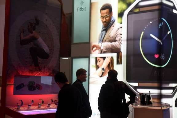 (FILES) This file photo taken on January 6, 2016 shows attendees as they look at wearable's near the FitBit booth at the CES 2016 Consumer Electronics Show in Las Vegas, Nevada.   The market for connected wearable devices jumped in early 2016, led by fitness tracker maker Fitbit, while Chinese group Xiaomi raced past Apple to second place, a survey showed May 16, 2016.Global sales of wearables -- a broad category that includes fitness bands, smartwatches and connected clothing, shoes and health gadgets -- rose 67.2 percent in the first quarter compared with a year earlier.  / AFP PHOTO / ROBYN BECKROBYN BECK/AFP/Getty Images