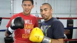 Boxer Miguel Flores (left) poses with sparring partner Rocky Juarez in 2013 in Houston.