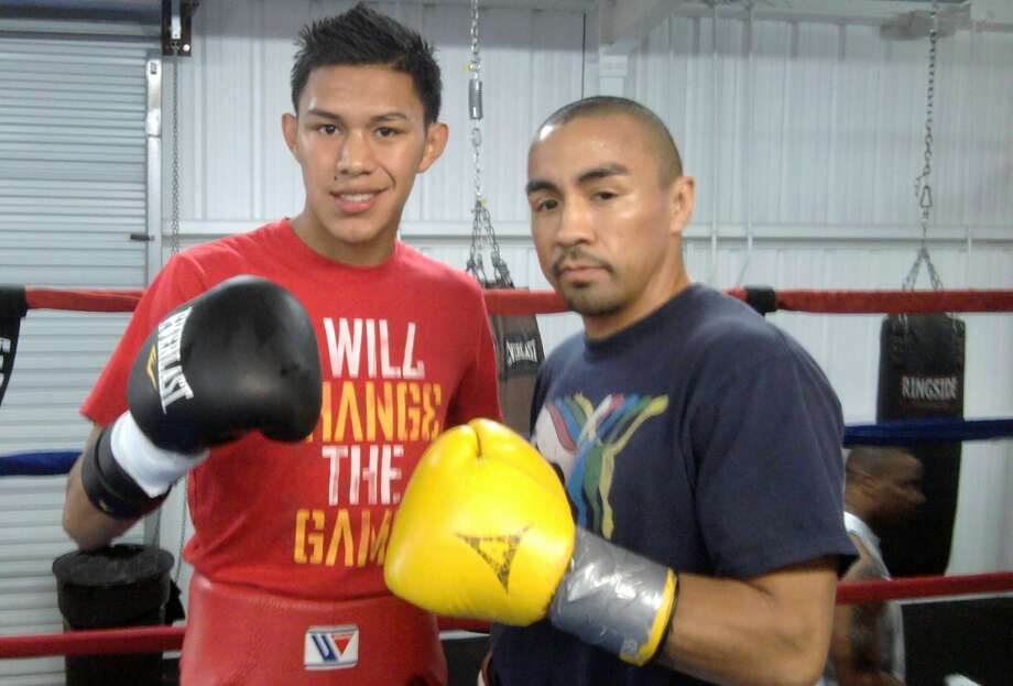 Boxer Miguel Flores (let) poses with sparring partner Rocky Juarez in 2013 in Houston. Photo: Peter Lim /For The Houston Chronicle / freelance
