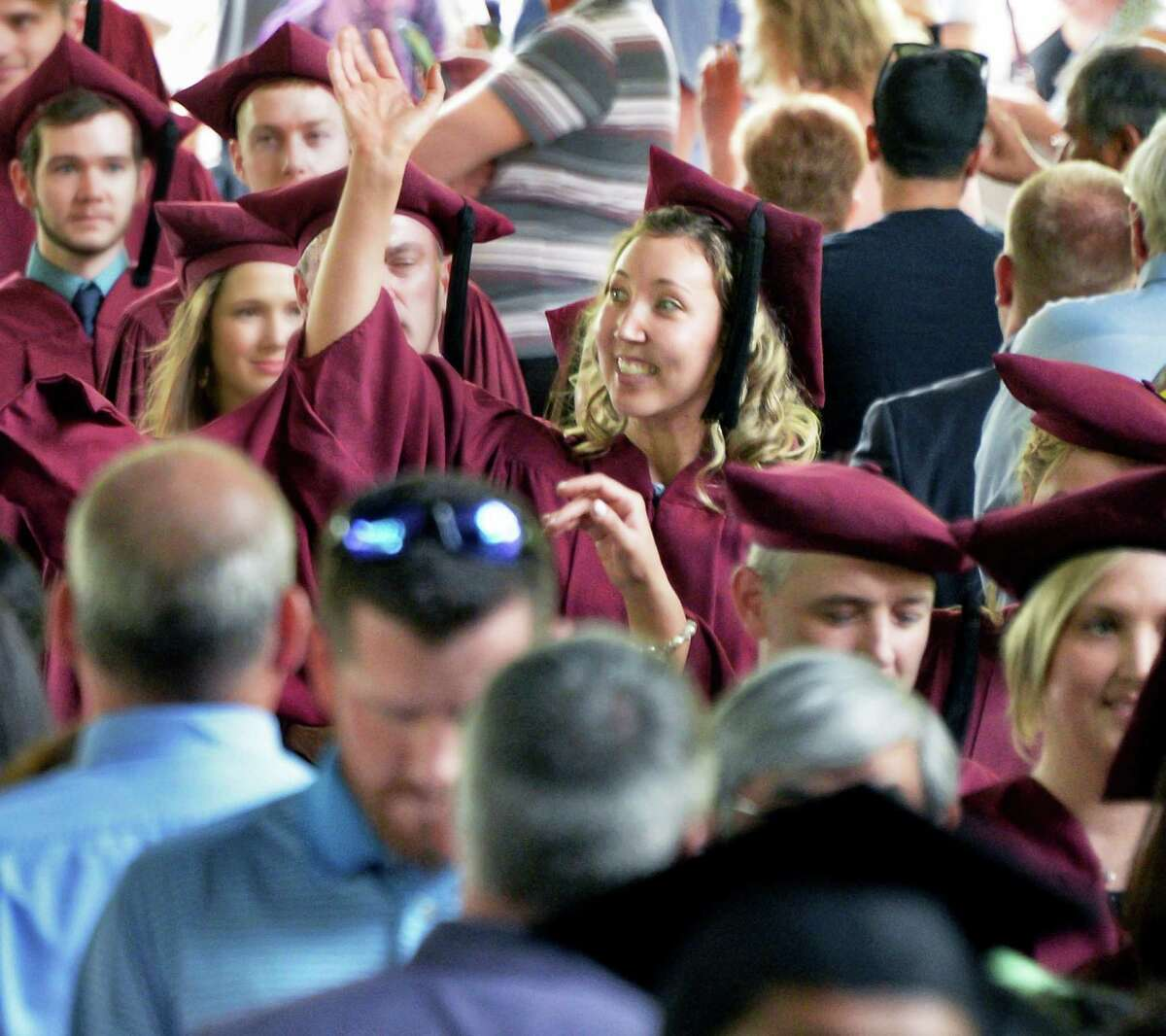 Albany Medical College graduate Madeline Nahow of Cornwall-on-Hudson waves as she enters commencement ceremonies Thursday May 26, 2016 in Saratoga Springs, NY. (John Carl D'Annibale / Times Union)