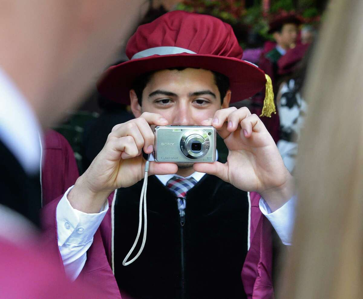 Albany Medical College graduate Craig Rovito of Colonie photographs classmates during commencement ceremonies Thursday May 26, 2016 in Saratoga Springs, NY. (John Carl D'Annibale / Times Union)