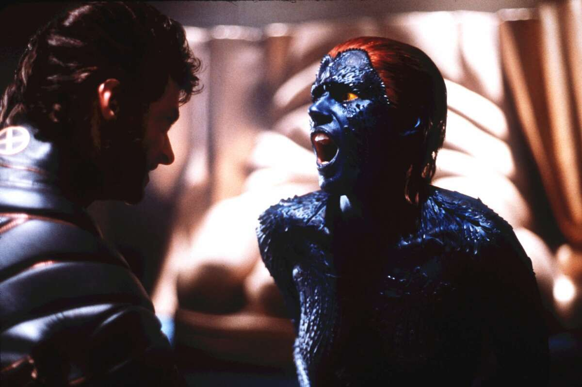 ADVANCE FOR WEEKEND EDITIONS, JULY 13-16--Wolverine, left, played by Hugh Jackman, and Mystique, played by Rebecca Romijn-Stamos, square off in a deadly duel in this scene from the 20th Century Fox film 'X-men,' which opens in theaters July 15. Born in the wildly popular Marvel Comics series, the X-men are outcasts whose genetic mutations give them such powers as telepathy, rapid healing and shape-lifting. Fans of the series have awaited a big-screen treatment of their favorite comic heroes and villains for as long or longer than wider audiences longed for a new 'Star Wars' flick. (AP Photo/HO,20th Century Fox, Attila Dory)