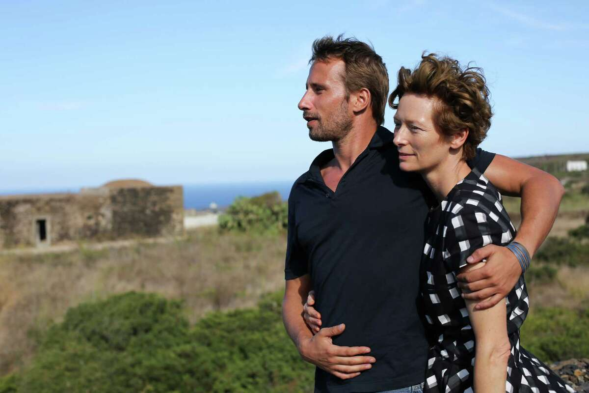 This image released by Fox Searchlight shows Tilda Swinton, right, and Matthias Schoenaerts in a scene from