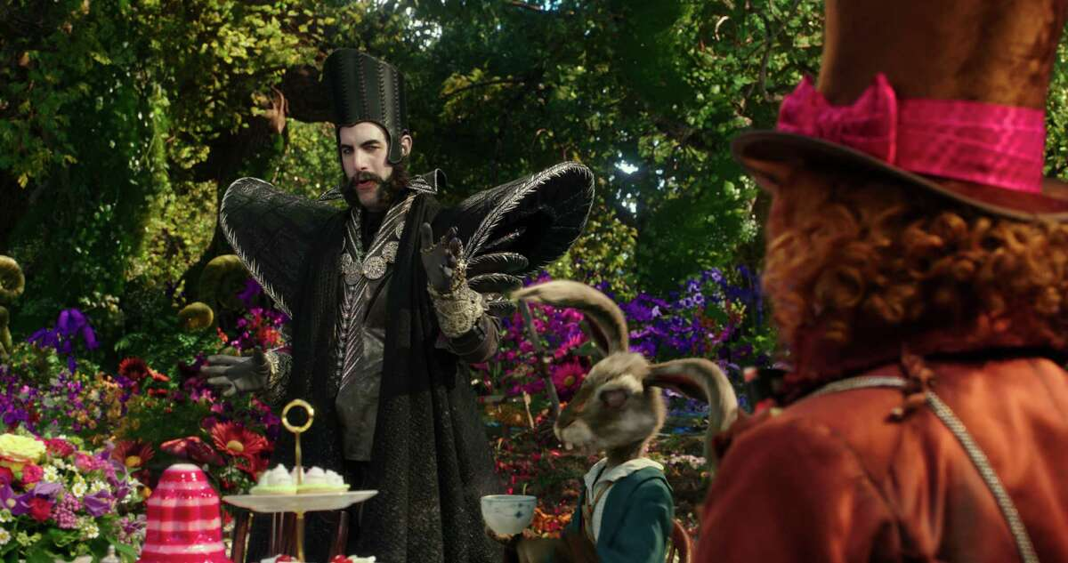 In this image released by Disney, Sacha Baron Cohen, left, and Johnny Depp appear in a scene from