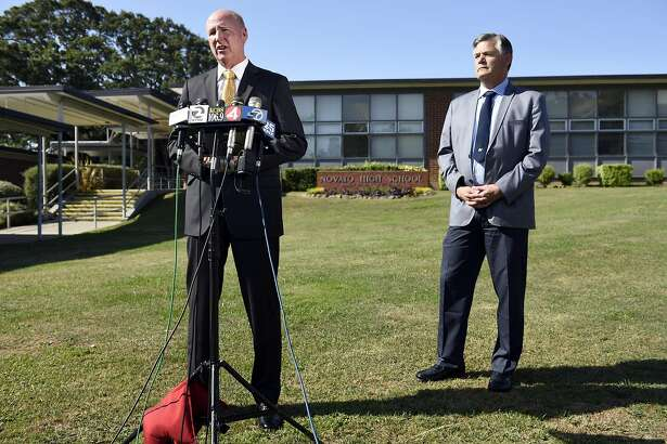 Lt. Doug Pittman of the Marin County Sheriff's Department, left, speaks as Novato Unified School District Superintendent Jim Hogeboom looks on during a press conference held at Navato High School in Novato, CA Thursday, May 26th, 2016, addressing the double shooting that involved two students from the school.