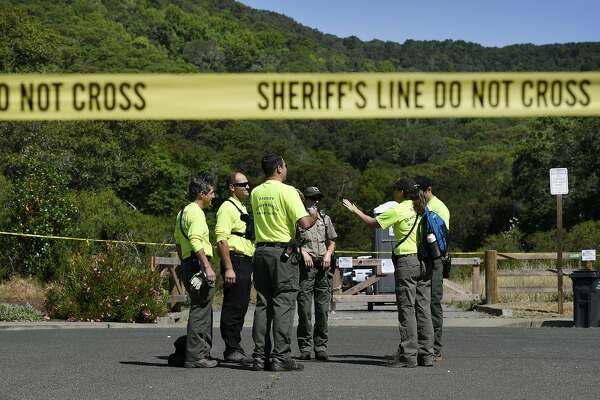 Volunteers with the Marin County Sheriff's Search and Rescue Team get ready to search the trail on the Indian Valley Preserve which is the scene of a double shooting involving students from Novato High School in Novato, Calif., Thursday, May 26, 2016.