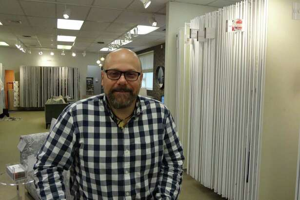 James Botelho, manager of Kravet's showroom, on May 26, 2016 in the company's Stamford, Conn. location on Fairfield Avenue. Botelho helped lead the creation of the Stamford Waterside Design District, formed in May 2016 to increase visibility for neighboring businesses.