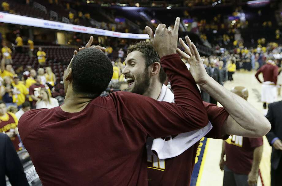 Kevin Love hugs Cavaliers teammate Channing Frye, who had offered words of advice before the game, after their Game 5 win. Photo: Tony Dejak, Associated Press