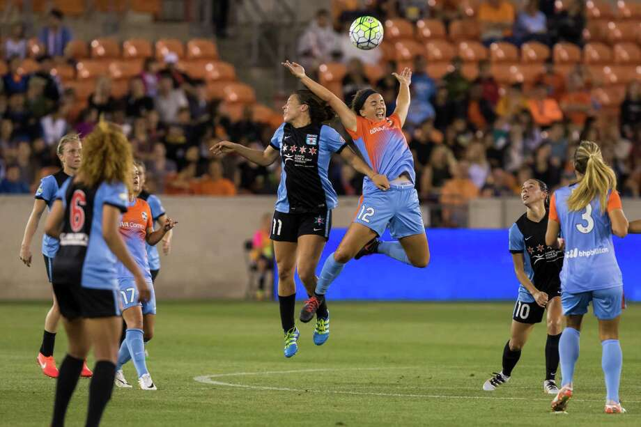 Red Stars forward Sofia Huerta (11) and Dash midfielder Amber Brooks (12) go up for a header in the first half of a National Women's Soccer League game at BBVA Compass Stadium on Saturday, April 16, 2016, in Houston,TX. ( Joe Buvid / For the Chronicle ) Photo: Joe Buvid, Freelance / © 2016 Joe Buvid