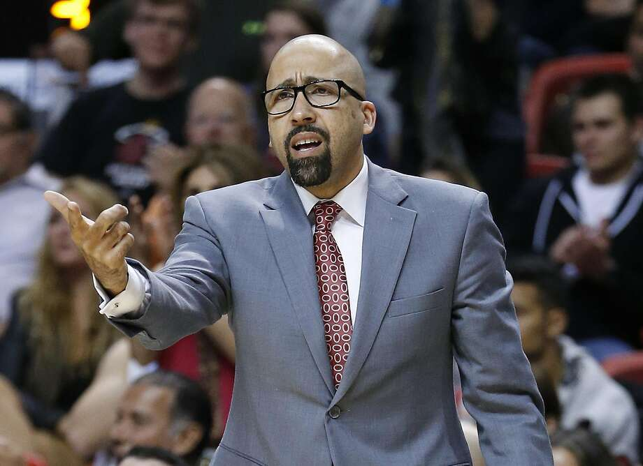 FILE - In this Nov. 2, 2014, file photo, Miami Heat assistant coach David Fizdale gestures during the team's NBA basketball game against the Toronto Raptors in Miami. A person with knowledge of the negotiations says the Memphis Grizzlies have offered their head coaching job to Fizdale. The person says Fizdale met with Grizzlies controlling owner Robert Pera on Wednesday, May 25, in California and that the job had been offered. The person spoke to The Associated Press on condition of anonymity because the Grizzlies are not commenting on specific candidates in their coaching search. (AP Photo/Joel Auerbach, File) Photo: Joel Auerbach, Associated Press