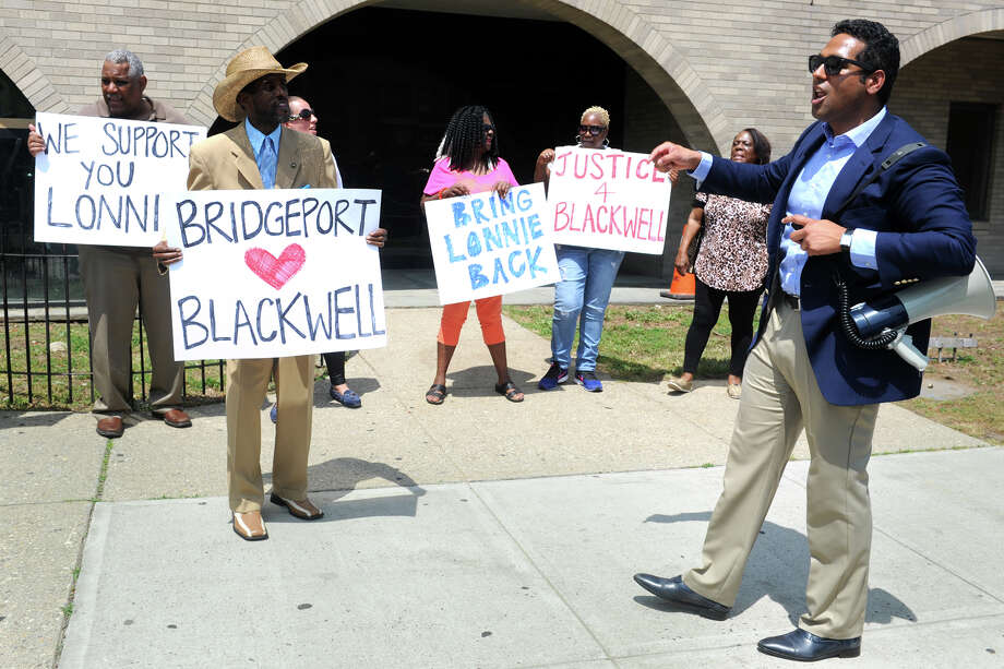 Dennis Bradley, right, leads a protest in front of Bridgeport police headquarters on Thursday. Bradley, president of the Bridgeport Board of Education, and others expressed support for Lt. Lonnie Blackwell, who was in a disciplinary meeting with police Chief Armando Perez. Photo: Ned Gerard / Hearst Connecticut Media / Connecticut Post