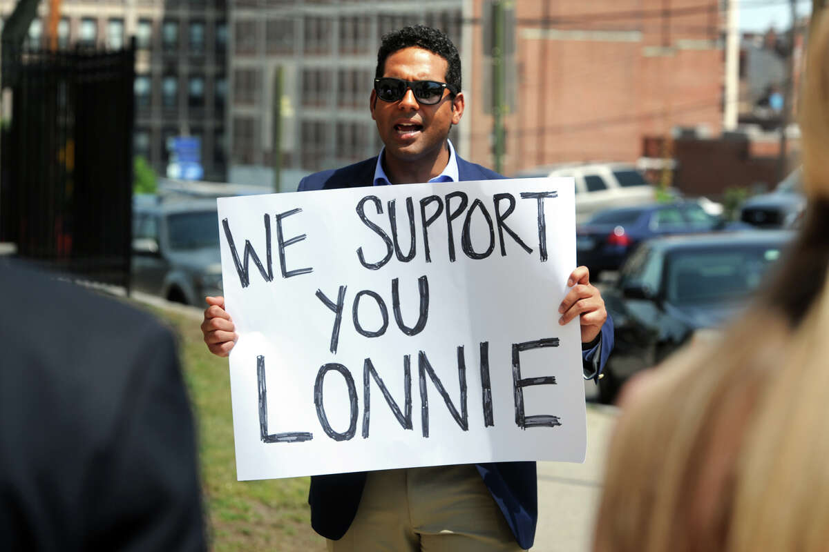 Dennis Bradley leads a protest in front of Bridgeport Police Headquaters, in Bridgeport, Conn. May 26, 2016. Bradley, President of the Bridgeport Board of Education, and others gathered to express their support for Bridgeport Police Lt. Lonnie Blackwell, who was meeting with Chief Armando Perez potention termination.
