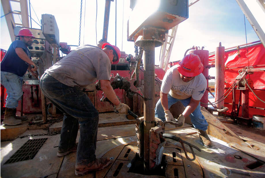 Drillers in Midland install a 90-foot section of pipe on a rig in February. The U.S. Energy Information Administration estimates that global oil demand will grow from 94.8 million barrels a day this year to 105.3 million barrels in 2026. Photo: James Durbin /Midland Reporter-Telegram / © 2016 Midland Reporter Telegram. All Rights Reserved.